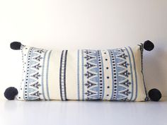 Bohemian Blue and White Pillow with Pom Poms by theestateofthings