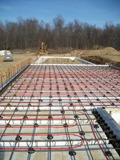 Insulated concrete forms with radiant floor heating system Find a Contractor in… Icf Home, Steel Framing, Insulated Concrete Forms, Concrete Floors, Concrete Formwork, Concrete Footings, Radiant Floor, Pole Barn Homes, Radiant Heat
