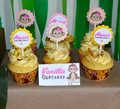 Vanilla cupcakes at a monkey birthday party! See more party planning ideas at CatchMyParty.com!