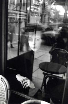Tel un fantôme, une femme qui attend... / Le Café La Tartine; / Paris, France. / Photo by Edouard Boubat,1980.