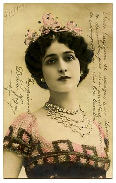The famous Italian Opera Star, Lina Cavalieri (1874-1944). This postcard, showing her all decked out in a pink tiara, and loads of jewels.