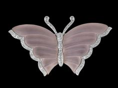 """Lady's Eighteen-Karat White Gold, Diamond and Rose Quartz Butterfly Pin, the pin composed of seventy-two round brilliant cut diamonds with a total approximate weight of 0.86 carats, l. 2-1/2""""."""