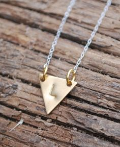 Tiny little triangle! Get your initial stamped on this brass little triangle with sterling silver chain! You can have gold filled chain if you