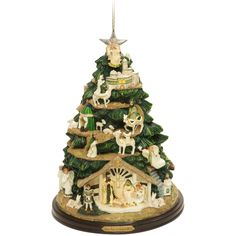 "Thomas Kinkade Irish Nativity Tree Ornament    Thomas Kinkade, the famous Painter of Light has designed this truly unique, one of a kind, ""Irish Nativity Tree Ornament."" The birth of Jesus unfolds on this handcrafted 5"" nativity ornament with gold accents featuring an Irish motif and LED light to illuminate the creche, scenes and star."