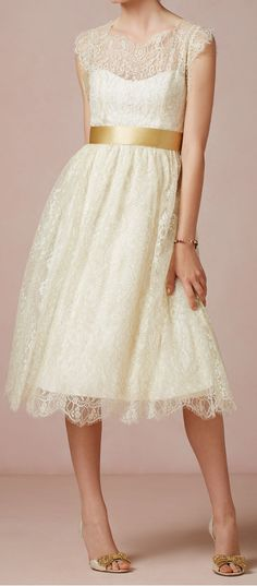 this white dress with gold ribbon..