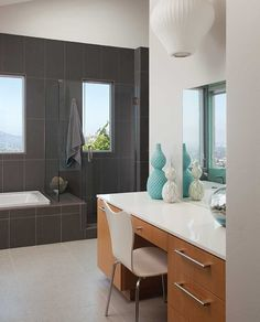 Nestled near the top of Mount Helix, a master bathroom addition takes advantage of natural light and panoramic vistas.