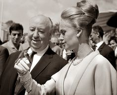 Alfred Hitchcock and Tippi Hedren are accompanied to the Cannes film festival by two lovebirds
