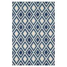 Anchor your living room seating group or define space in the den with this artfully hand-tufted wool rug, featuring a bold diamond motif for eye-catching app...