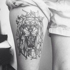 Geometrical and origami lion head tattoo. Perfect place!