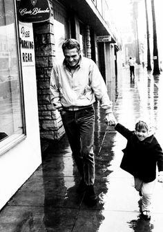 Steve McQueen and his daughter Terry walking around Los Angeles, 1964.