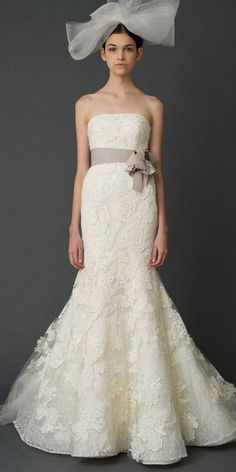Vera Wang strapless wedding dress- love this!! (minus the giant bow on the head)