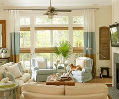 A subdued tropical-beachy feel is the design motif of choice for this bright and sunny living area. Traditional colors of browns, blues, whites, and neutrals seamlessly blend, while comfortable slipcovered furniture invites f Living Room Photos, Living Room Decor, Living Area, Bungalow Living Rooms, Brown And Blue Living Room, Relaxation Room, Family Room Design, Family Rooms, Furniture Placement