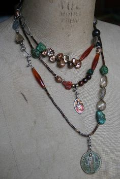 Turquoise and Stones - segments of various seed beads separate larger stones