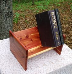 The BlackWater Book Rack - Eastern Red Cedar Book Rack from BlackWater Workshops by BlackWaterWorkshops on Etsy