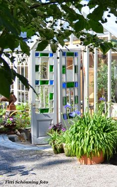 Stain glass doors on this greenhouse at Tittis Garden