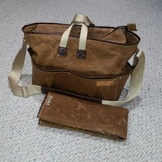 Preparing to package and ship a custom request waxed canvas messenger style diaper bag to a new Daddy to be!   A great bag that holds up through the diaper years and transitions easily to your favorite messenger tote bag.  Handmade with pride.