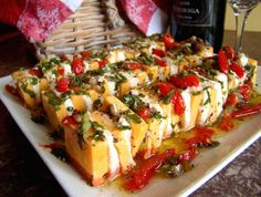 Marinated Cheese Appetizer from Food.com:   								This recipe was given to me by a friend. I have made it several times, and it doesn't last long! It does take a while to prepare, but it is worth it. Great presentation and delicious flavors.