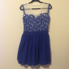 Beautiful blue dress Blue dress with white mesh on the chest. The waistband has is stretchable. V-neck and covered back. No trades. Dresses