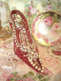 I Made this Marie Antoinette inspired  red shoe  using vintage aurora borealis jewels ...will be on my web site www.mylulabelles.com
