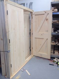 Framed, ledged, braced and battened double doors.