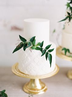 Two tier wedding cake with greenery: http://www.stylemepretty.com/2017/03/27/modern-warehouse-wedding-ideas/ Photography: Kristine Herman - http://www.kristineherman.com/