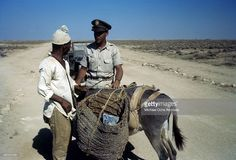 A local tribesmen with a donkey is stopped by a member of the 376th Bombardment Group at the U.S Air Force Base in Benghazi, Libya.