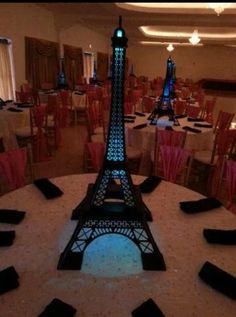Eiffel Tower Center Pieces If you are in the RGV in Texas they are available to be rented. They are made of wood and light up to your specific color or colors.