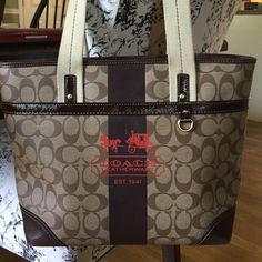 "Coach Zipper Tote Brown with leather and patent detail. This tote is clean with no scratches were well taken care of. Non smoking home. This measures approximately 10"" high 12"" by 4"". Perfect for laptop, book and magazines. Coach Bags Totes"
