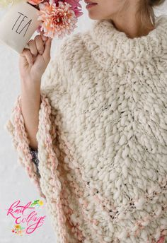 We love the details here on our boho Rustic Handspun Poncho so much! This poncho is the perfect project for intermediate crocheters! It has loose and oversized in fit and can be worn as a sweater or layered as a jacket. It is made with just 5 skeins of our soft and fluffy 100% wool Spun Cloud yarn. Have you knit this poncho? If so, please share your photos or leave a comment below. #knitponcho, #ponchopattern, #knittingpatterns, #diy, #knit #knitting #handspunyarn #handspun #chunkyyarn