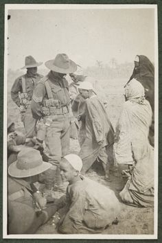 """"""" Australian Infantry Battalion - Mena Camp, Cairo, 1914 - Locals bartering with soldiers 'Marida' - the favourite Kik-Kik Local labourers at work building a picture show. World War One, First World, Troops, Soldiers, Anzac Day, Cairo, Picture Show, Egypt, Africa"""