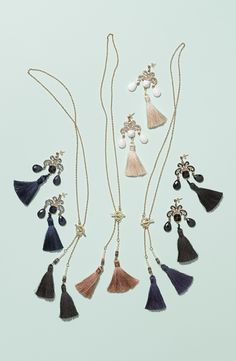 Adding a hint of 20's influence to the fall wardrobe. In love with this tassel necklace and earring collection.