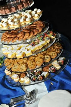 Glass dessert tower with cookies, puffs, and tarts - yum!