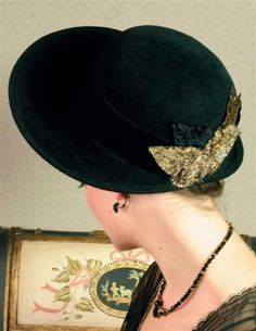 Miss Alcott hat - A wide brim shades the eyes while a cluster of teastained millinery blooms grasp the nape of the crown in a pretty, 19th c. design. Sumptuously soft, and timelessly classic. A signature elasticized silk band ensures a custom fit.