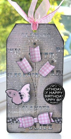 handmade birthdayt tag from Kath's Blog......diary of the everyday life of a crafter: A box of Goodies.... ...shabby chic look ... lavender, pink & purple ... sweet flowers and paper bow in gingham print ...