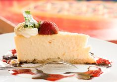 Our delicious cheesecake with sweet cream and chocolate, vanilla and raspberry sauce!