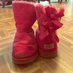 Betty bow pink uggs  These pink ugh a have been worn , they also do have a a bleach stain on them as you can see , they also can get cleaned at the cleanser but I'm not to sure about the bleach stain  UGG Shoes Winter & Rain Boots