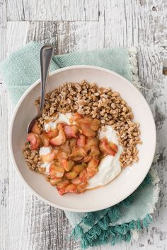 A delightful breakfast bowl packed with cook farro, yogurt, and a tangy roasted maple rhubarb from @NaturallyElla