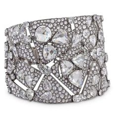 Designed as a tapering openwork cuff, composed of abstract angular sections pavé-set with rose, circular and pear-shaped diamonds, accented with large triangular and round and heart-shaped rose-cut diamonds connected by fancy-cut stones, mounted in white gold, signed Carnet, 2014. Total diamond weight 48.17 carats.