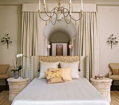 Fabric Frames a Floating Bed    Traditional pleated bed draperies allowed interior designer Denise Macy to think outside the box when arranging furniture in her Chicago home's master bedroom. Instead of backing up the bed to a wall, she floated it in the middle of the room, then framed it with drapery panels fabricated from a sophisticated Nancy Corzine fabric in a subtle solid hue.       Interior design: Denise Macy