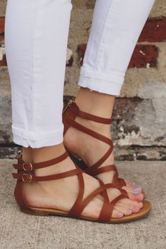 Flat, faux leather strappy sandals with zipper back and double ankle strap.