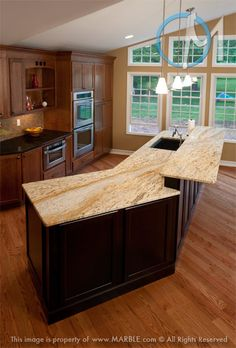 This Colonial Gold dual-level island features an interesting angle on the first level, and showcases the stone's veining pattern quite nicely.