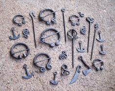 Steel brooches and pendants 1 by Astalo on deviantART