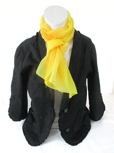 In a spectacular golden yellow with white geometric pattern, the light natural fabric keeps you warm in winter and cool in summer meaning it is an ideal gift for any loved one.  This unique artwork has been hand painted on a 100% silk scarf which is sumptuously soft and light to wear. It makes a stunning gift or a perfect treat for yourself.