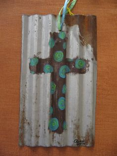 love this cross on old tin!!