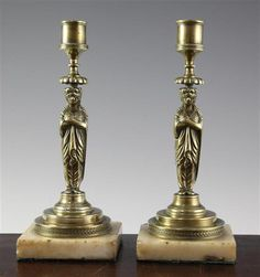 A pair of 19th century French brass candlesticks, 8.5in.