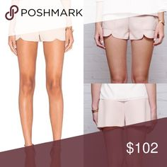 GREYLIN KRISSA WOVEN SHORTS These chic pair of blush Krissa shorts feature slash patch side pockets, slits on hem in the front, and belt loops. It has single welt pockets and a concealed side seam zipper. Greylin Shorts