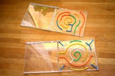 sticky strings (or whatever they're called) used to make a maze inside a CD case--neat idea! (blog not in English)