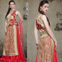 A high-neck long #choli in #contrast colour with the #red #lehenga looks stylish and modern!  #LehengaCholi #FloralMotif #Volume #Layers #Embroidery #Designer #Occasion #IndianDresses #Partywears #Indian #Women #Bridalwear #Fashion #Fashionista #OnlineShopping