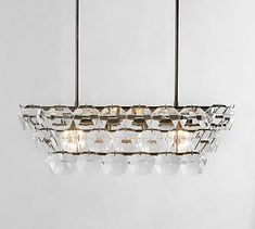 The geometric shape of the Bowen Chandelier's sculptural crystals makes this lighting an updated take on a traditional design. A hand-applied pewter finish completes the look. Round Crystal Chandelier, Wood Bead Chandelier, Rectangular Chandelier, Antler Chandelier, Outdoor Chandelier, Pottery Barn, Bubble, Candle Cups, Shimmer Lights