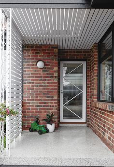 All brick front entryway with white and glass contemporary front door